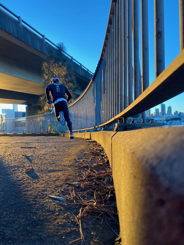 man running fast on bridge